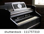 Old Style Black Piano In An Ol...