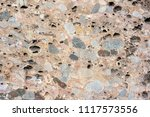 an old gray stone wall in the... | Shutterstock . vector #1117573556