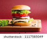 delicious burger on red... | Shutterstock . vector #1117585049