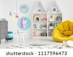 yellow pouf in colorful child's ... | Shutterstock . vector #1117596473