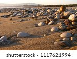 sicily  italy  river stones on... | Shutterstock . vector #1117621994