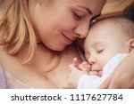 young mother holding newborn... | Shutterstock . vector #1117627784