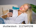 beautiful and happy blond woman ... | Shutterstock . vector #1117649198