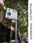 Small photo of 15 minutes with disable parking sign only on busy street Sydney city CBD downtown, Australia
