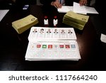 an election official holds a... | Shutterstock . vector #1117664240