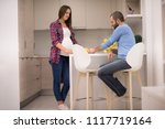 young pregnant couple cooking... | Shutterstock . vector #1117719164