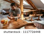 shot of a young man using his...   Shutterstock . vector #1117726448