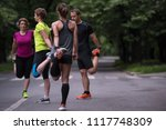 healthy runners team warming up ... | Shutterstock . vector #1117748309