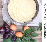 dough for pie from fresh plum... | Shutterstock . vector #1117767773