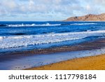 picturesque waves of a surf at... | Shutterstock . vector #1117798184