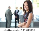 Stock photo face of beautiful woman on the background of business people 111780053