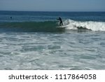 surfer riding surfboard on wave ... | Shutterstock . vector #1117864058