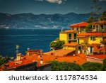 typical italian houses on... | Shutterstock . vector #1117874534