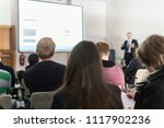 speaker giving a talk in... | Shutterstock . vector #1117902236