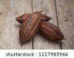 cocoa pod on a dark rustic... | Shutterstock . vector #1117985966