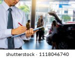 business man on car showroom... | Shutterstock . vector #1118046740