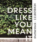 Small photo of Dress like you mean it. Words on wall. Words in the wild.