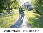 father with daughter walking in ... | Shutterstock . vector #1118065514