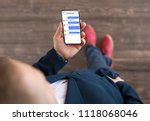 man using messaging app on phone | Shutterstock . vector #1118068046