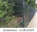 long and tall iron fence | Shutterstock . vector #1118115629