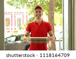 young man with pizza boxes at... | Shutterstock . vector #1118164709