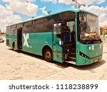 green bus egged open doors in... | Shutterstock . vector #1118238899