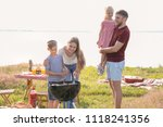 family cooking tasty food on... | Shutterstock . vector #1118241356