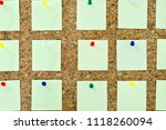 many blank post notes on cork. | Shutterstock . vector #1118260094