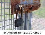 the closed lock is fixed to the ... | Shutterstock . vector #1118273579