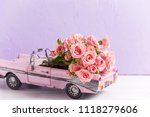retro car toy with pink roses... | Shutterstock . vector #1118279606