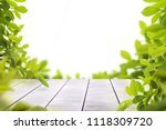 wooden table top with spring... | Shutterstock . vector #1118309720