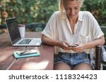 young caucasian woman sitting...   Shutterstock . vector #1118324423