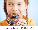 cute kid girl eating sweet...   Shutterstock . vector #111834518