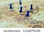 group of pins on old map. | Shutterstock . vector #1118370104