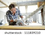 man using electric saw inside... | Shutterstock . vector #111839210