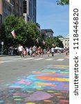 Small photo of Raleigh, NC/US- 09/25/2013: Visitors to downtown Raleigh walk past chalk art along Fayetteville St.