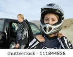 Постер, плакат: Motocross Racer Putting on