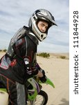 Постер, плакат: Motocross Racer sitting on
