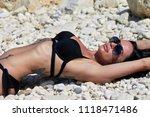 hot sexy brunette in a  black... | Shutterstock . vector #1118471486
