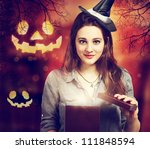 Halloween Cute Witch Opening a Box - stock photo