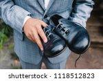 the bridegroom holds wedding... | Shutterstock . vector #1118512823