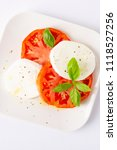 mozzarella and tomatoes with... | Shutterstock . vector #1118527256