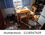 Small photo of Osaka, Japan - June 18, 2018: Food and appliances in jumbled mess on kitchen floor after earthquake in Takatsuki