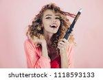 hairdresser. smiling curly hair ... | Shutterstock . vector #1118593133
