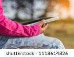 young girl using digital tablet ... | Shutterstock . vector #1118614826