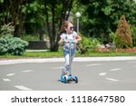 happy beautiful girl is riding... | Shutterstock . vector #1118647580