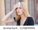 woman tired of heat in summer | Shutterstock . vector #1118690003