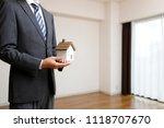 houses and businessmen | Shutterstock . vector #1118707670