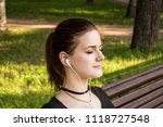 beautiful girl sits on a park... | Shutterstock . vector #1118727548