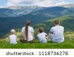 family holiday. parents and two ... | Shutterstock . vector #1118736278